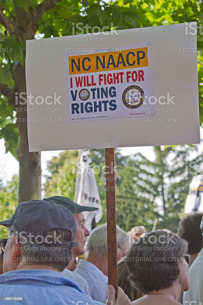 Moral Monday Protesters Hold NAACP Voting Rights Sign stock photo