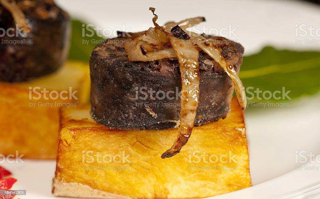 Morcilla on confit potato with onion royalty-free stock photo