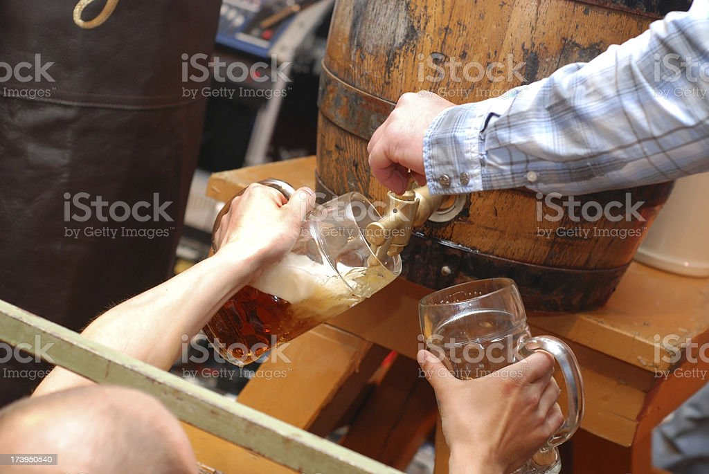 more beer - Bierzapfen beim Bieranstich stock photo