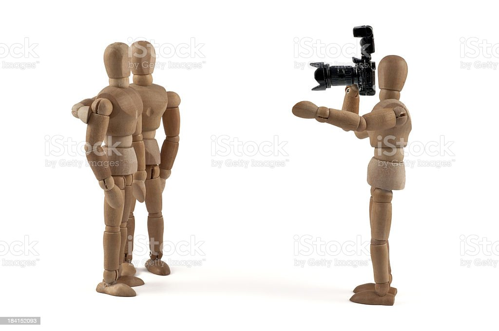more together! Wooden mannequin takes a photo stock photo