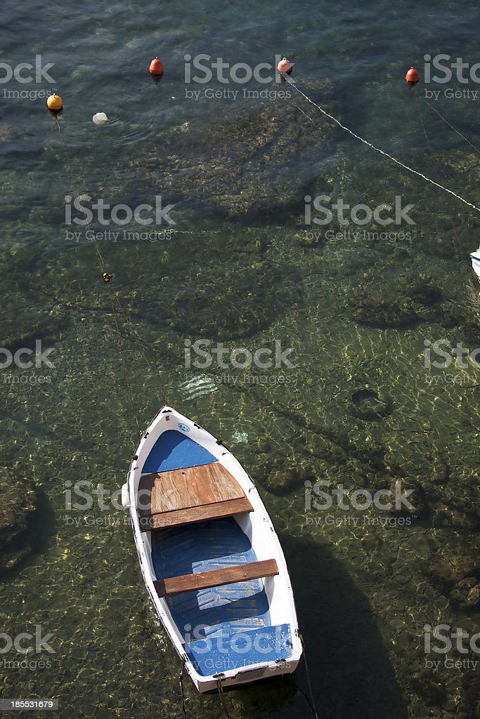 Mored on a green sea stock photo
