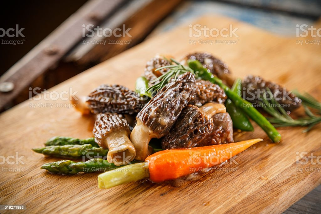 Morel Mushrooms on the cutting board stock photo