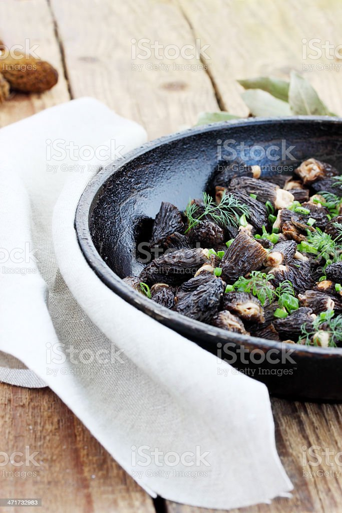 morels in a pan royalty-free stock photo