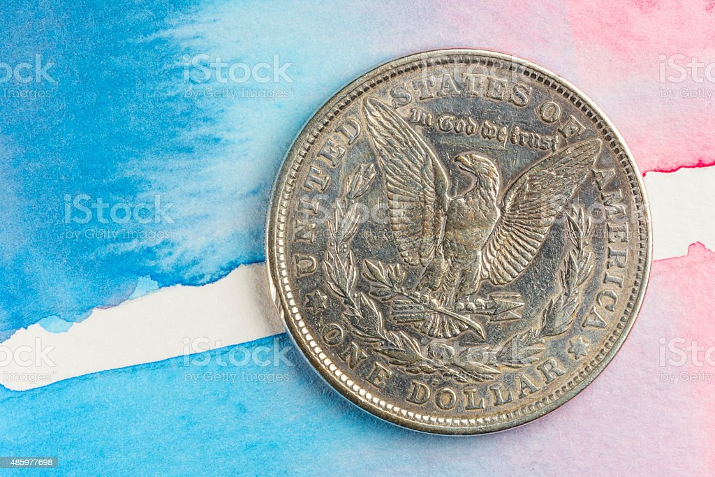 Morgan silver dollar on Water color Background stock photo