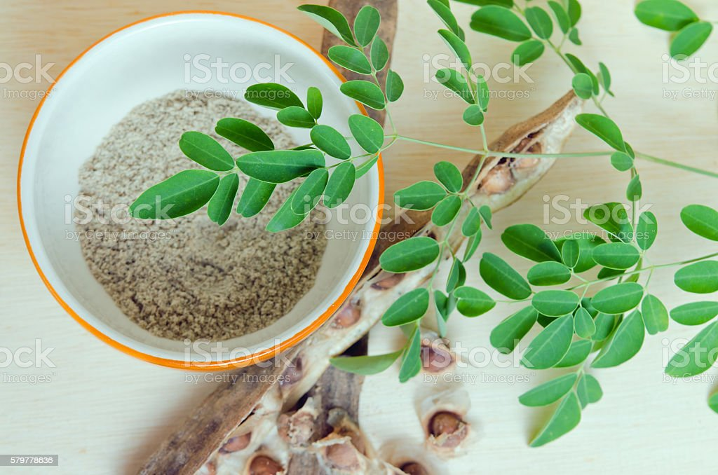 Moringa leaf and Moringa seed grinded in the bowl stock photo