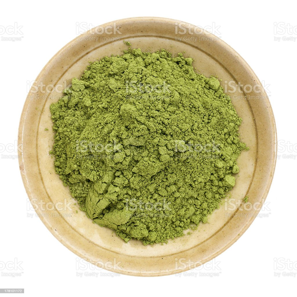 Moringa leaf powder in a bowl with white background stock photo