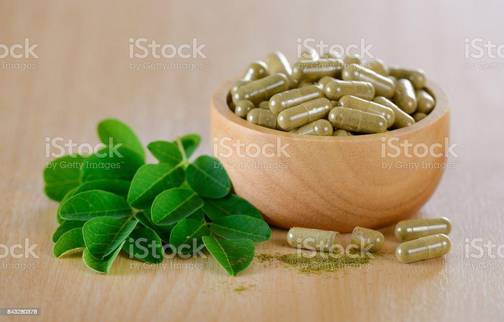 Moringa leaves and capsules (Herbs for health) stock photo