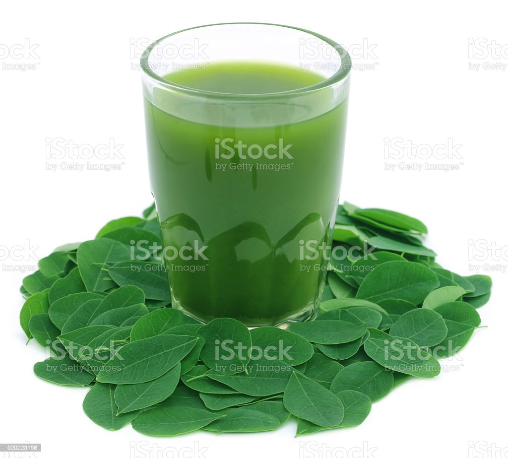 Moringa leaves with extract stock photo