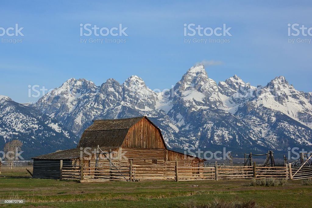 Mormon Row Barn with Tetons stock photo