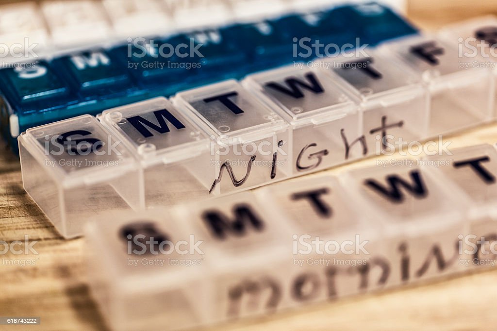 Morning and Night Seven Day Weekly Pill Containers stock photo
