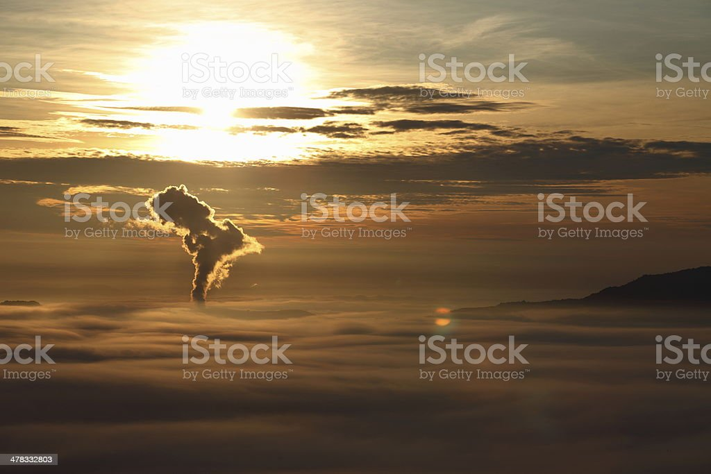morning and smoke rising from factories royalty-free stock photo