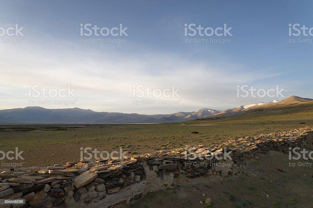 Morning at Himalayan lake near buddhist wall royalty-free stock photo