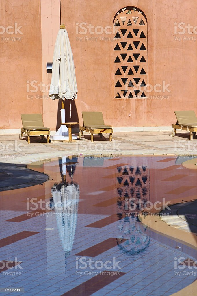 Morning at the luxury hotel baby pool royalty-free stock photo
