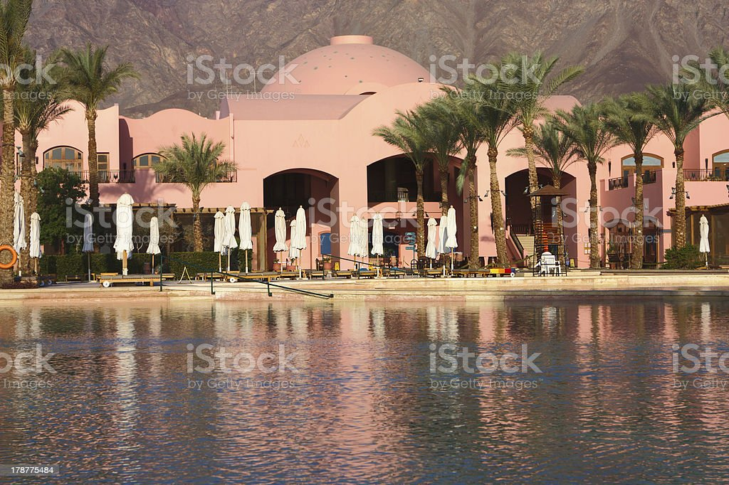 Morning at the luxury hotel swimming pool royalty-free stock photo