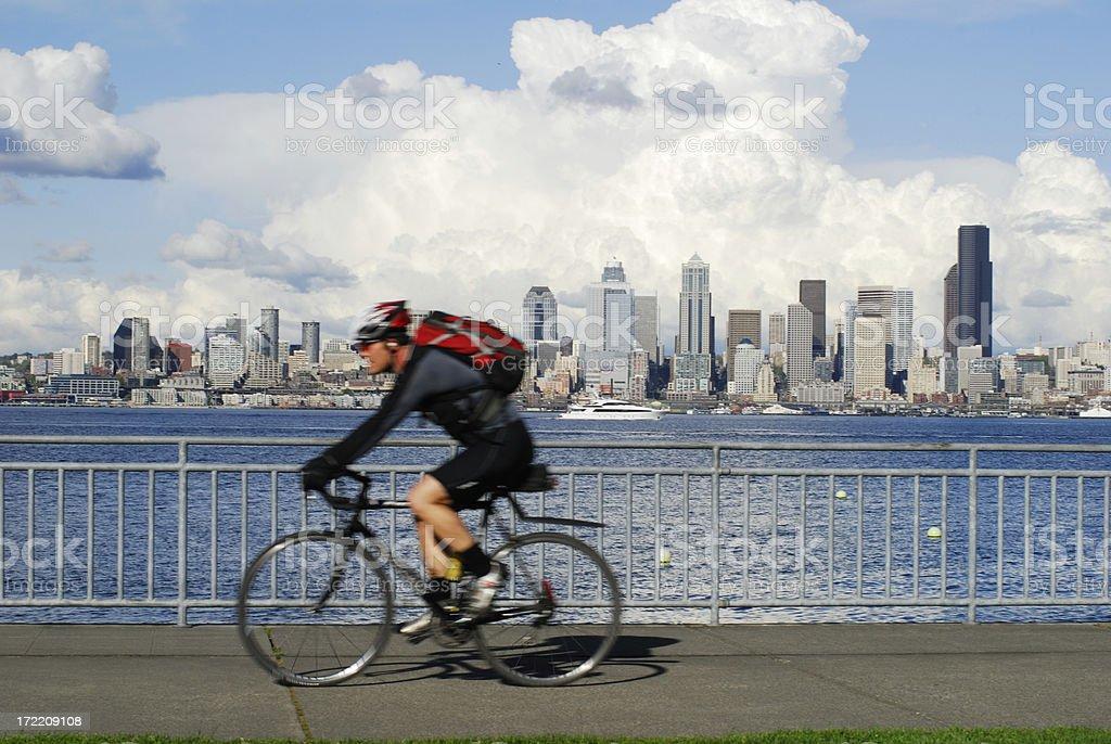morning bike ride against city skyline royalty-free stock photo