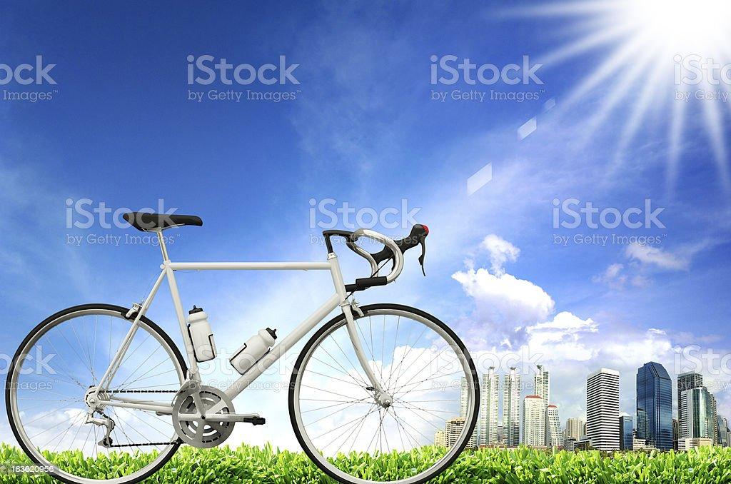 morning bike ride against city skyline stock photo