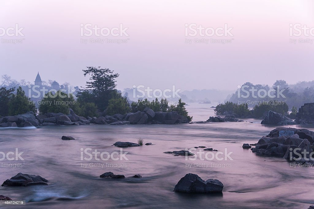 Morning breaks over the Betwa River in India's Orchha. stock photo