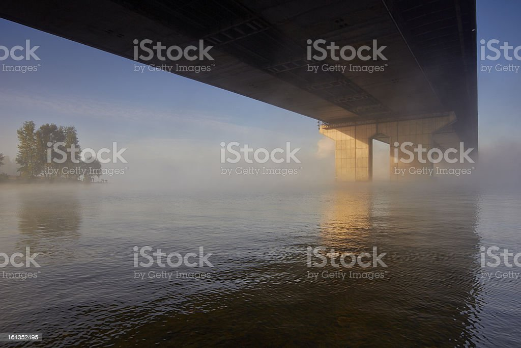 Morning bridge over the misty river. royalty-free stock photo