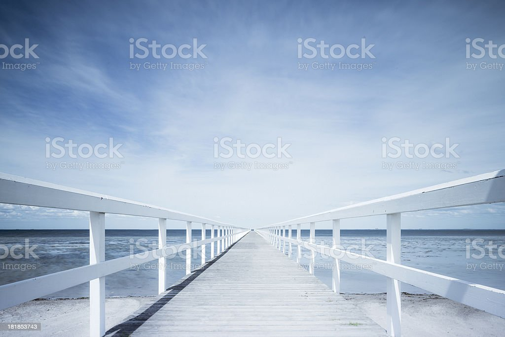 Morning by white wooden pier blue sky and beach (XXXLarge) stock photo