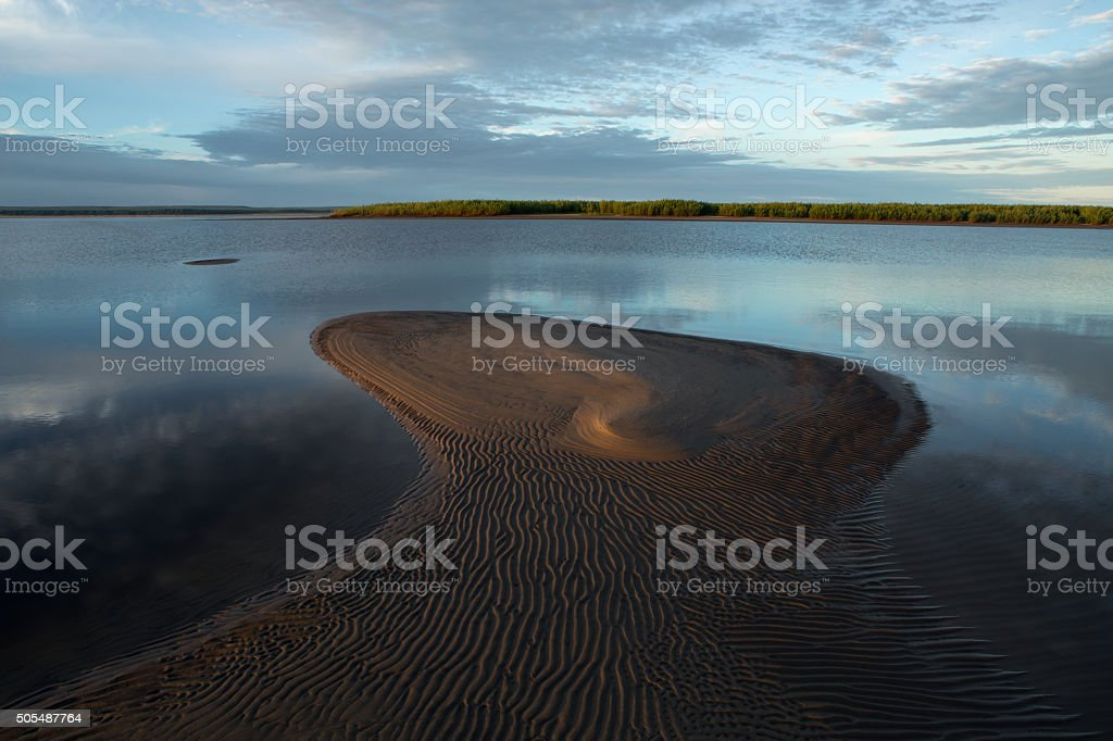 Morning calm river and the sand alluvium. stock photo