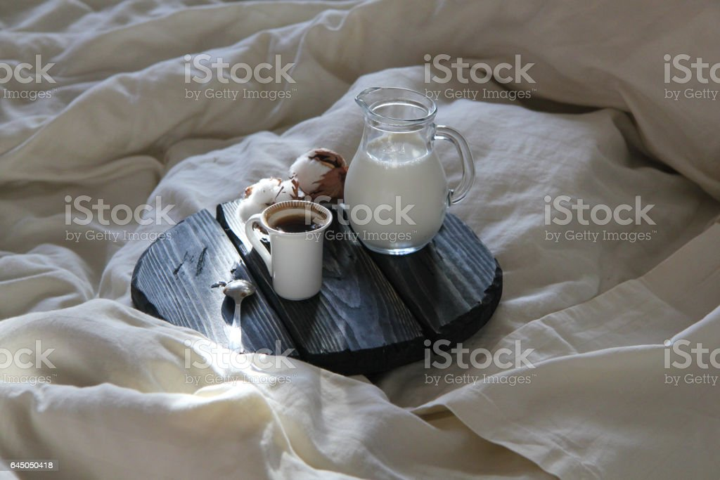 morning coffee and milk in bed and the sun's rays stock photo