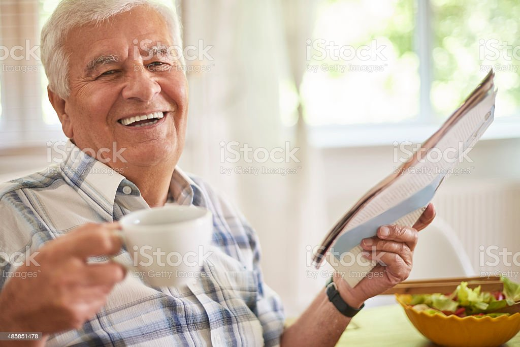 Morning coffee and newspaper is a great relaxation stock photo
