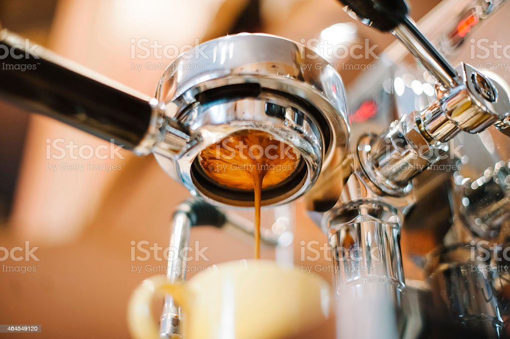 Morning coffee pouring through the bottomless portafilter stock photo