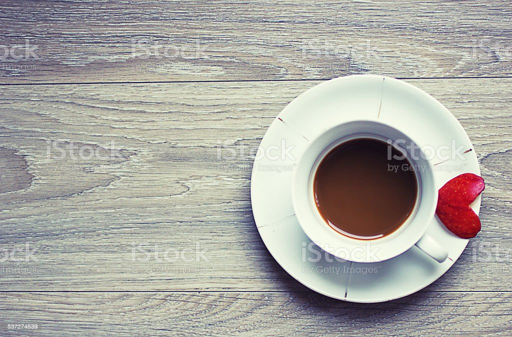 Morning coffee with a piece of love-top view stock photo