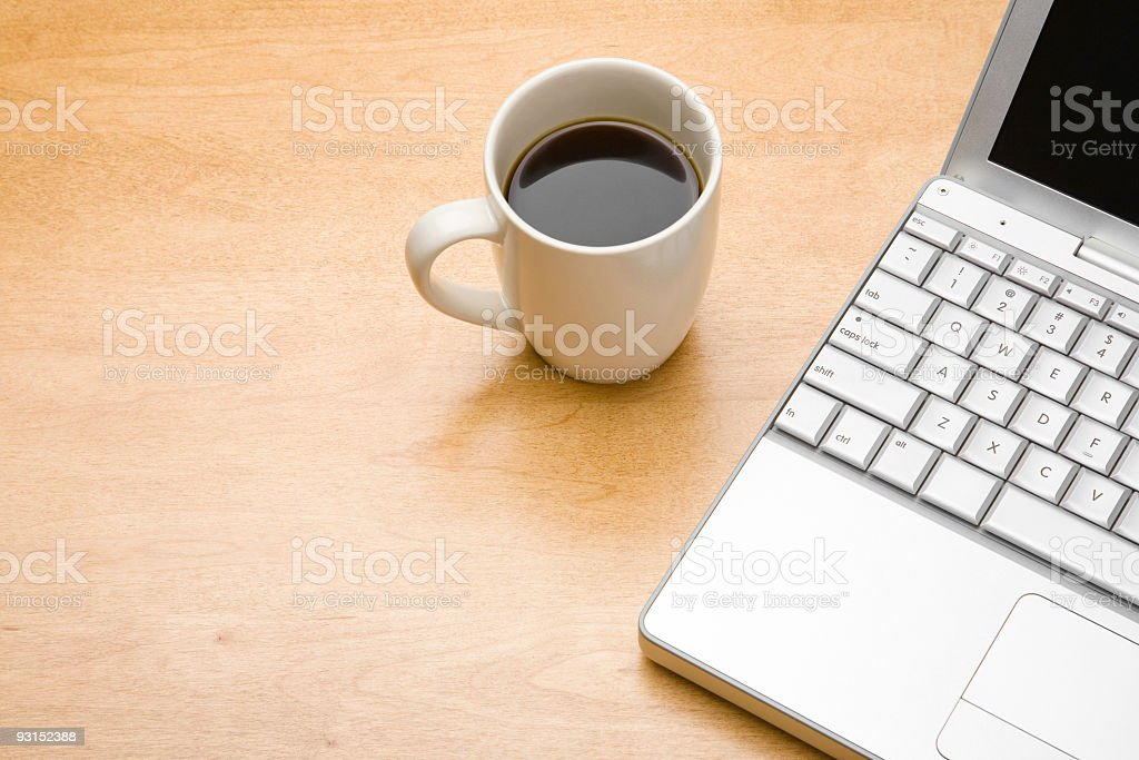 Morning coffee with laptop on desk royalty-free stock photo