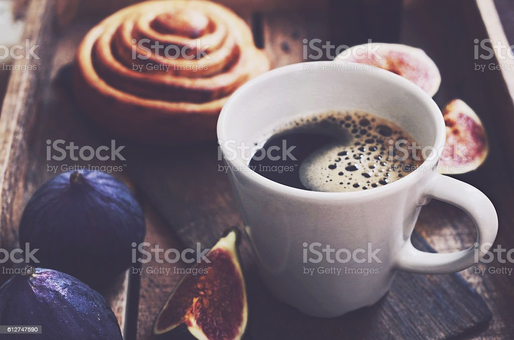 Morning cup of coffee, fruits and fresh bakery stock photo