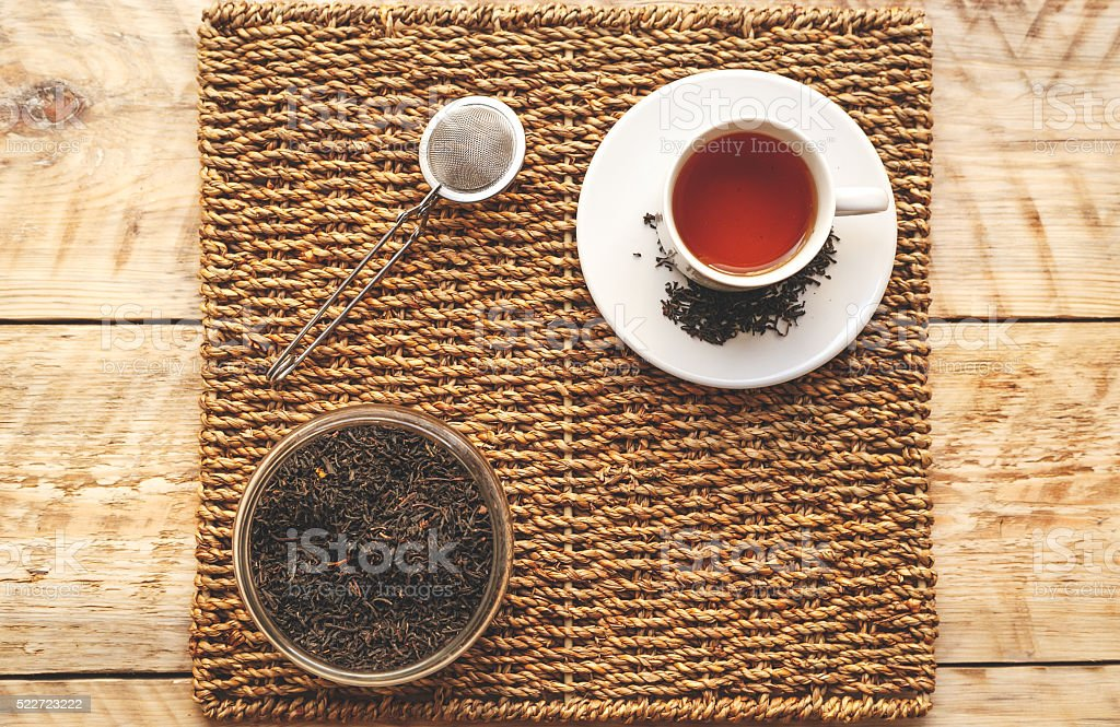 Morning cup of tea on a wooden table stock photo