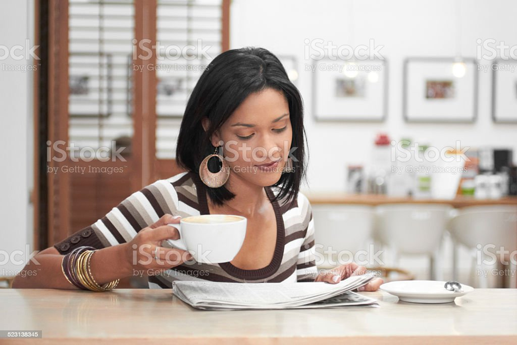 Morning dose of coffee and news stock photo