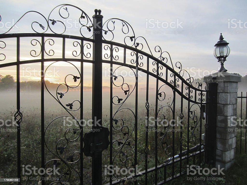Morning Fog and Sunrise Seen Through Iron Gate stock photo