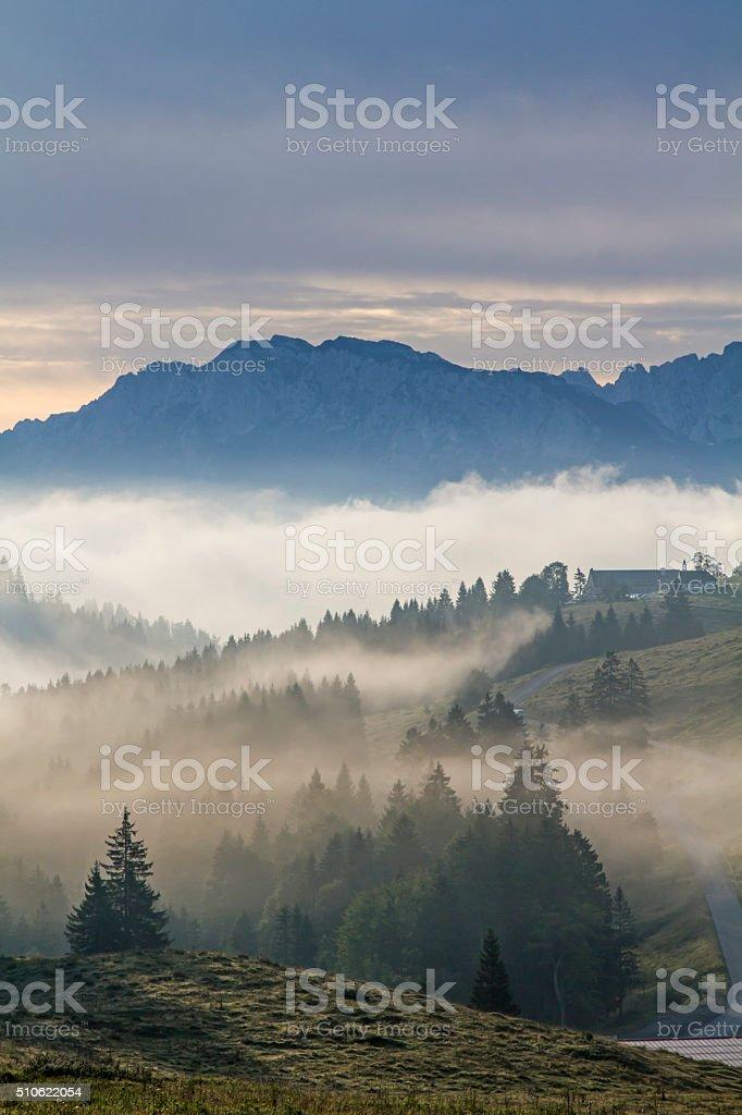 Morning fog at the Sudelfeld stock photo