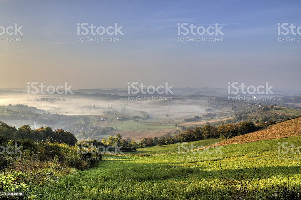 Morning fog in green valley royalty-free stock photo