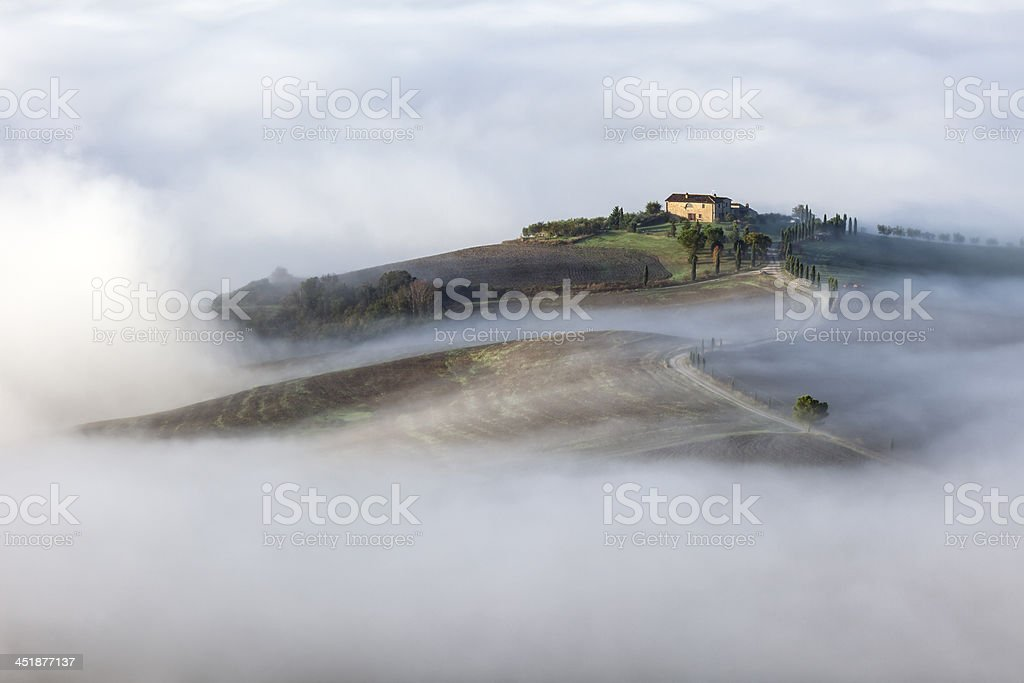Morning Fog in Orcia Valley, Tuscany, Italy royalty-free stock photo