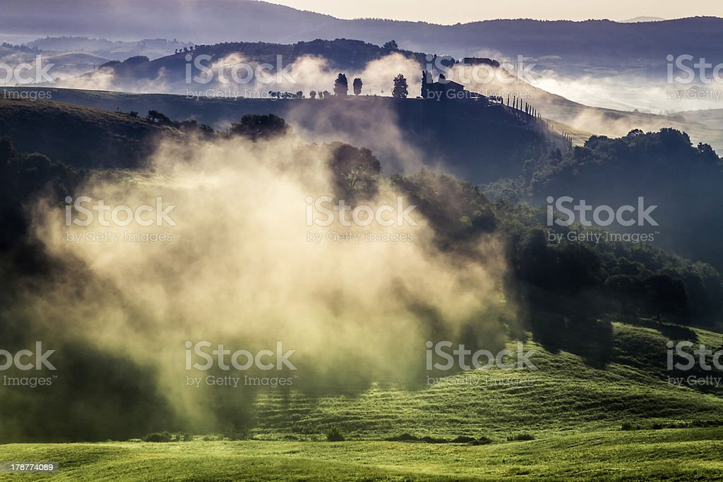 Morning fog in the valley between hills royalty-free stock photo