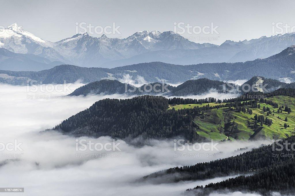 morning fog in the valley, Dolomiti stock photo