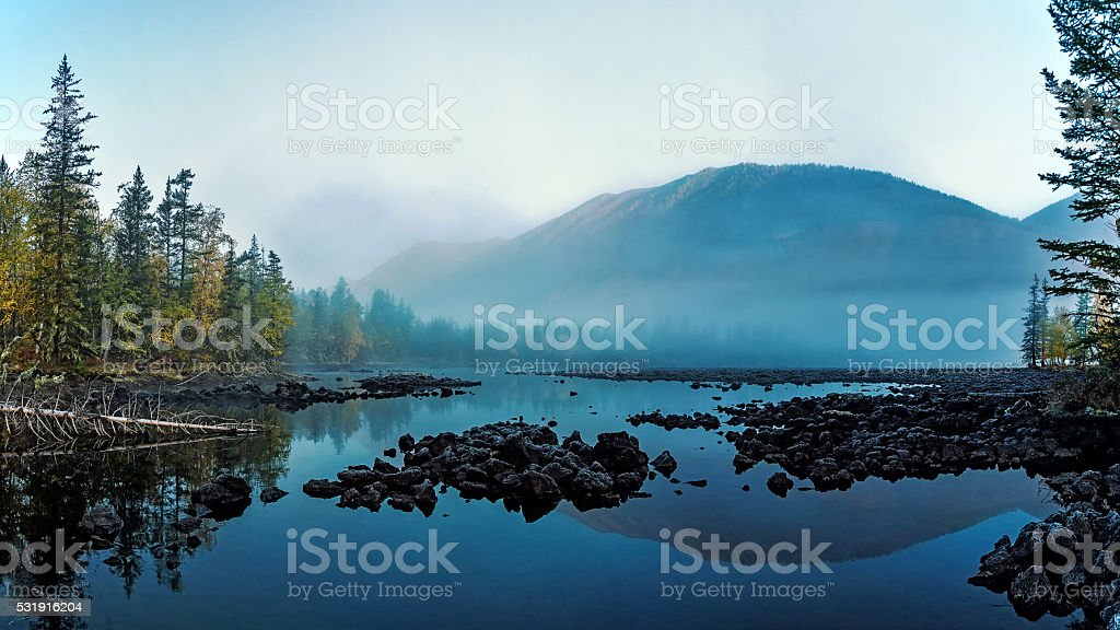 Morning fog in the valley of lava stock photo
