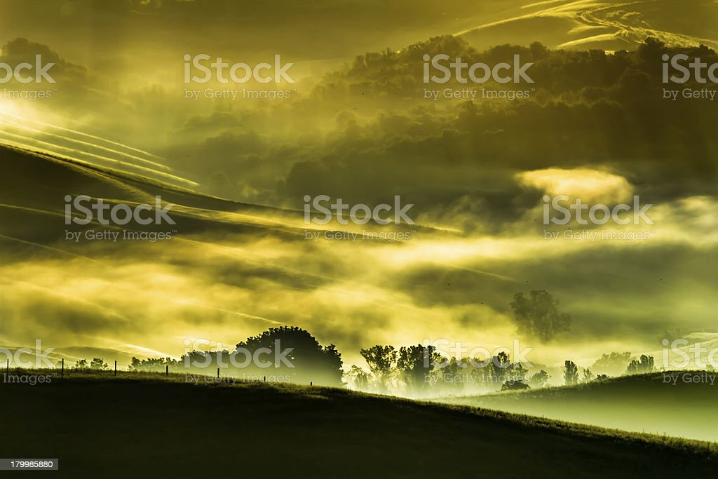 Morning fog in the valley of Tuscan royalty-free stock photo