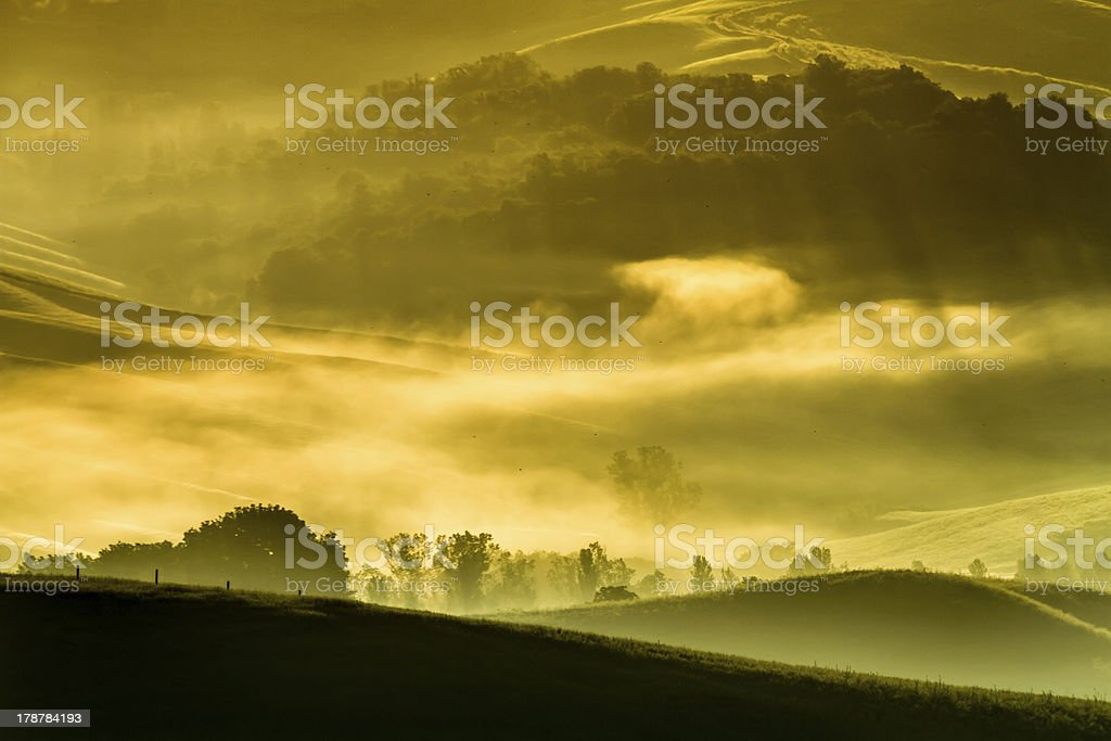 Morning fog in the valley, Tuscan royalty-free stock photo