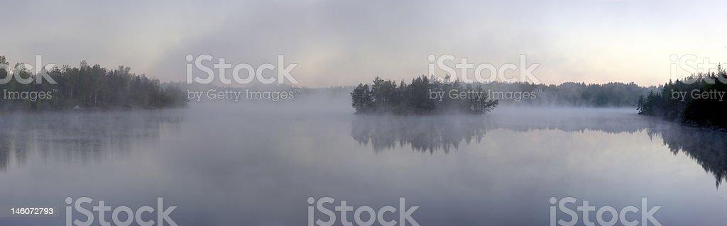 Morning fog on forest lake royalty-free stock photo