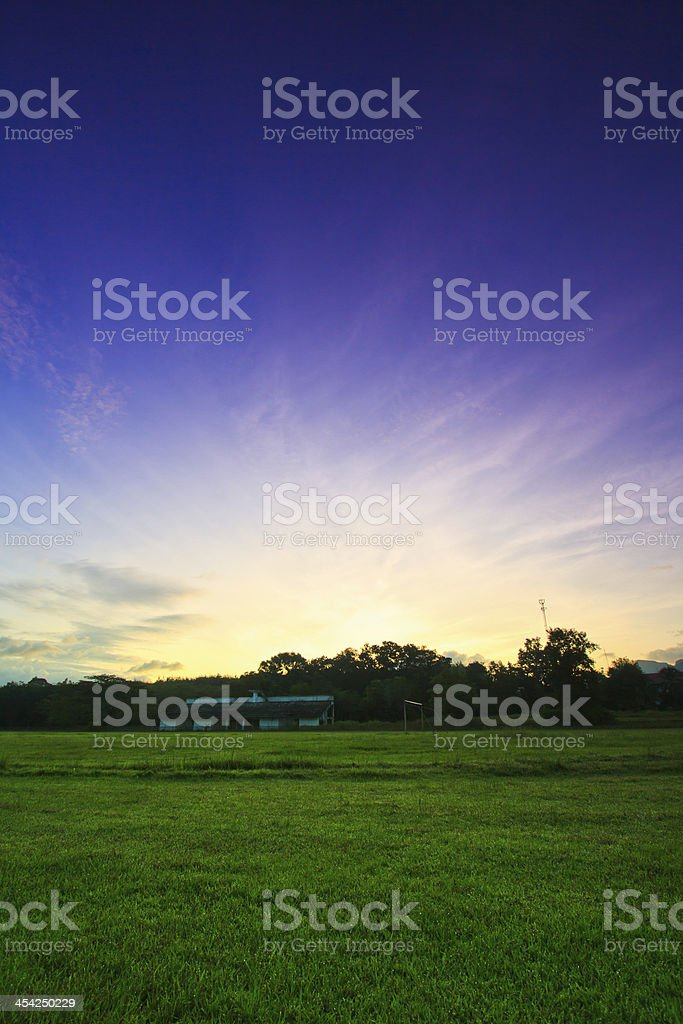Morning football  stadium with sunrise royalty-free stock photo