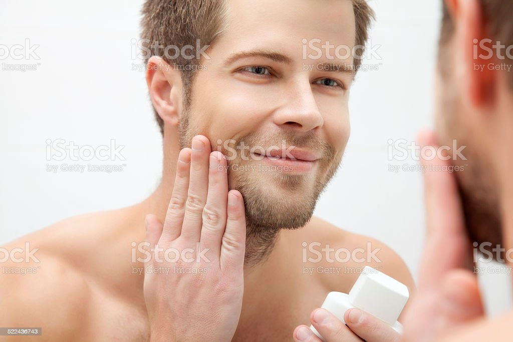 Morning hygiene in the bathroom stock photo