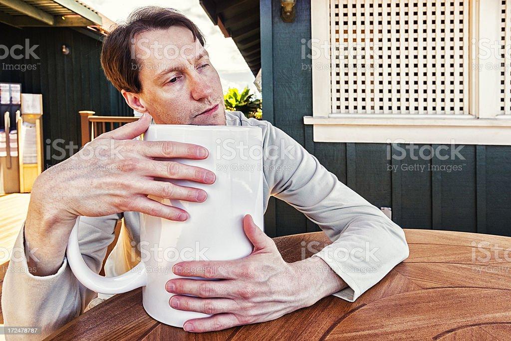 Morning Joe: Man Hugging a Giant Mug of Coffee royalty-free stock photo