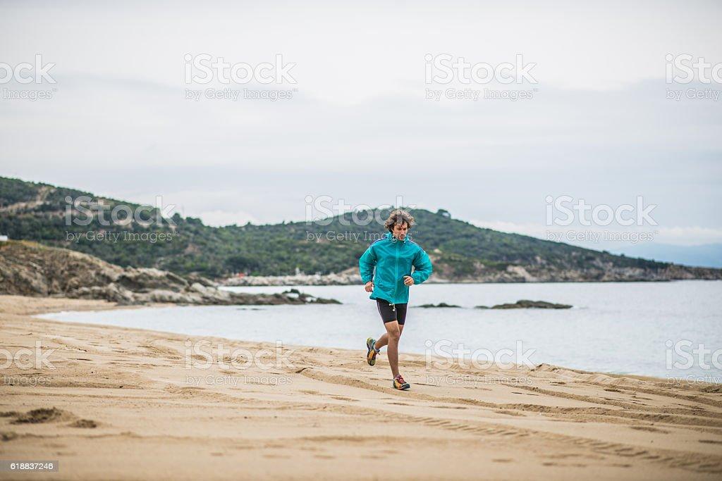 Morning jogging at the beach stock photo