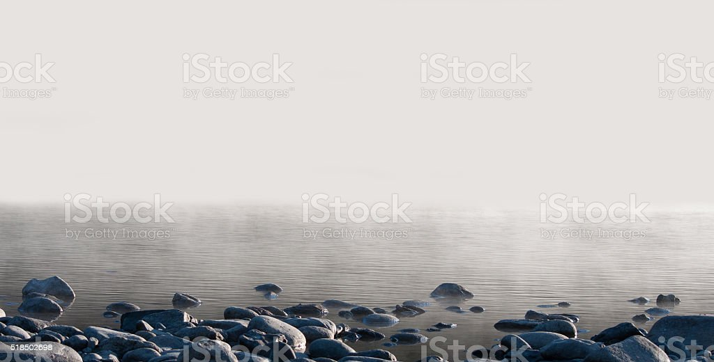 Morning lake in a fog. stock photo