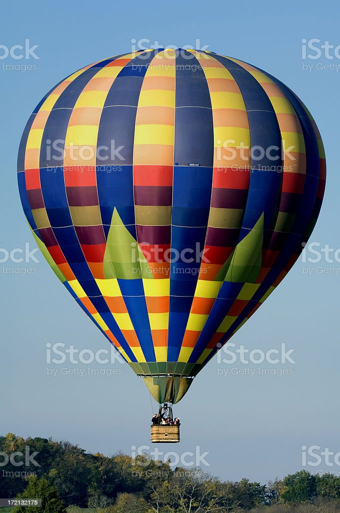 Morning Liftoff of a Brightly Colored Hot Air Balloon royalty-free stock photo