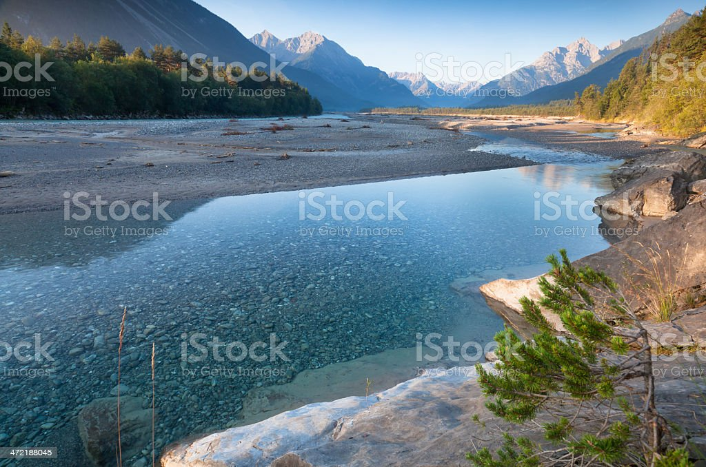 morning light lechriver, tirol, austria stock photo