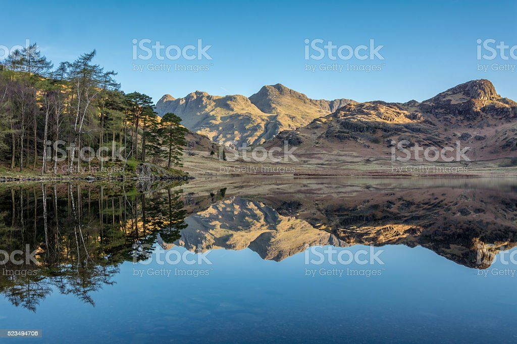 Morning Light On Mountains At Blea Tarn In Lake District. stock photo